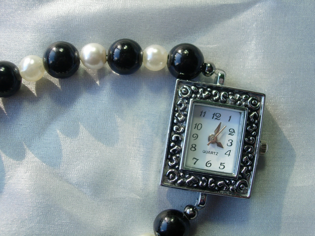Watch, black and ivory glass pearls