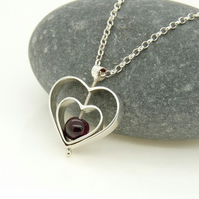 'Love' Heart Spinning Pendant in St Silver with Garnet