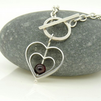 'Love' Heart Spinning Charm Bracelet in Sterling Silver with Garnet
