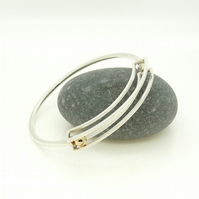 'Rolling' Kinetic Bangle in Sterling Silver with 9ct Gold