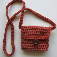 Small rust coloured crochet hippy shoulder puse
