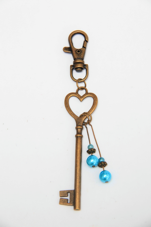 Large bronze keyring with blue pearls