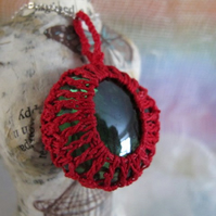 Red Crochet Necklace with Green Glass.
