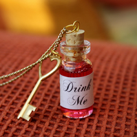 Red Drink Me long charm necklace