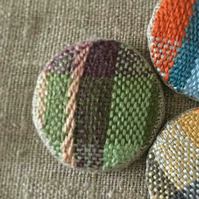 Handwoven button brooch green and pink