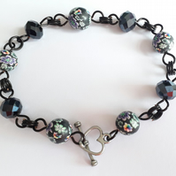 Black Blue Crystals and Rainbow Coloured Floral Black Polymer Clay Bead Bracelet