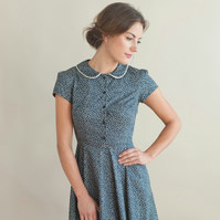 Navy floral dress with piped edged collar
