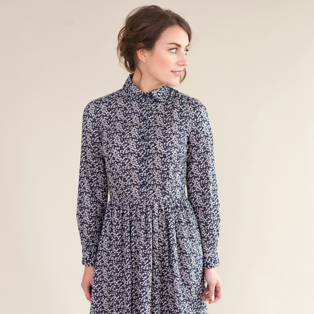 Long sleeved floral dress with rounded collar