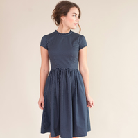 Navy spotty dress with ruffled neckline