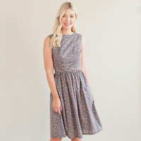 Sleeveless dress with gathered skirt