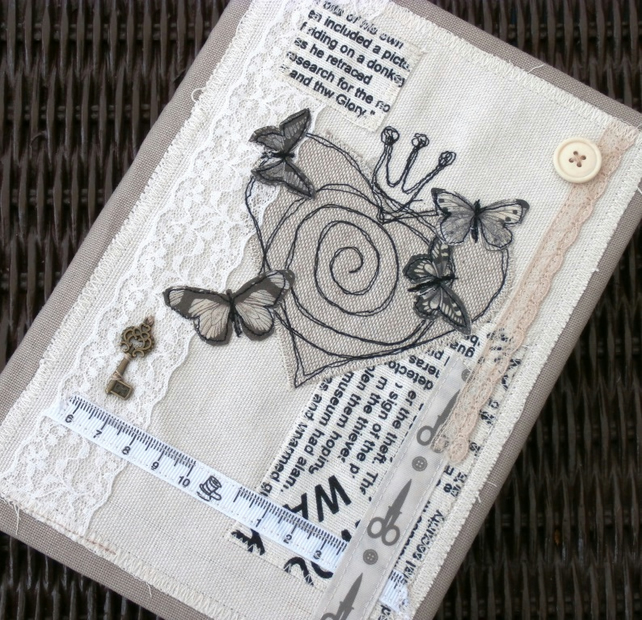 Embroidered and appliqued covered journal.