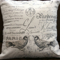 Cushion with printed birds.