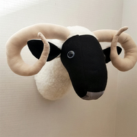 Faux taxidermy ram sheep head.