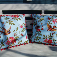 Pretty flower and bird cushions