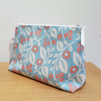 'Lucy' cosmetic bag in blue and coral