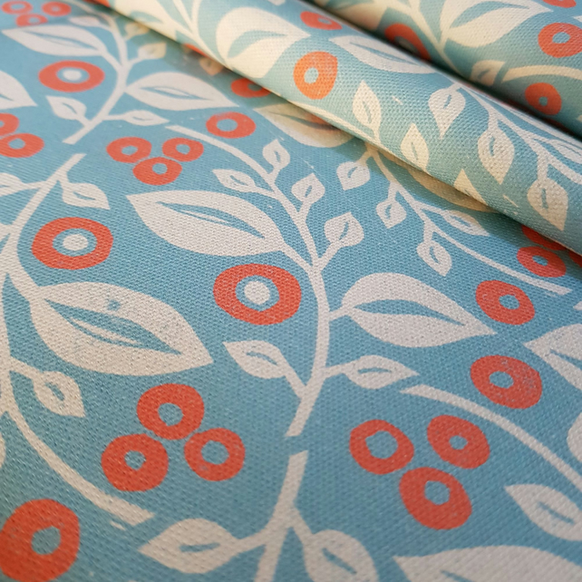 'Lucy' fabric in blue and coral.