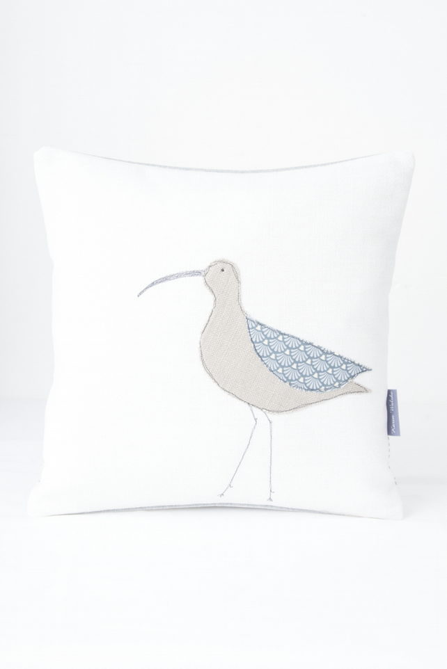 Applique Cushion Curlew, pale brown bird, grey beak, duck egg blue wing, stripes