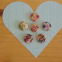 Six wooden painted buttons