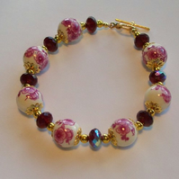 Elegant Floral Porcelain and Raspberry Coloured Bead Bracelet with Toggle Clasp
