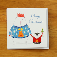 polar bear and penguin in knitted jumper christmas card