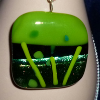 Handmade glass pendant with a dichroic accent, in green tones