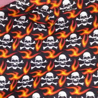 skull & crossbones cotton fabric- black with red & orange flames halloween