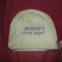 Baby hat in cream fleece fabric -lilac writing mummys little angel