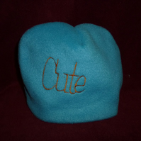 Hand made sewn baby hat in soft fleece fabric -blue with orange cute design