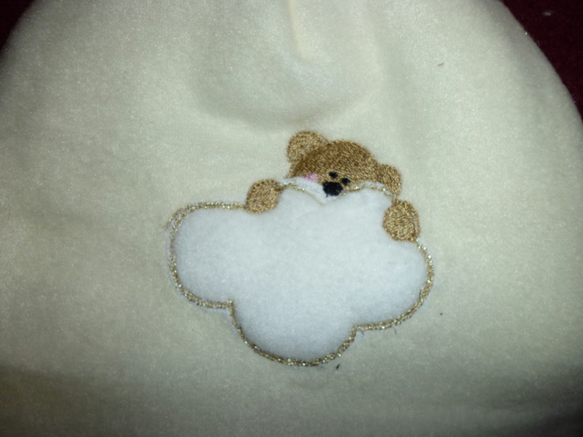 Hand made sewn baby hat in soft fleece fabric -cream with bear image