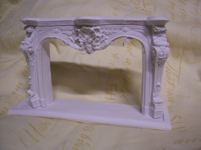 Ornate miniature dolls house firesurround