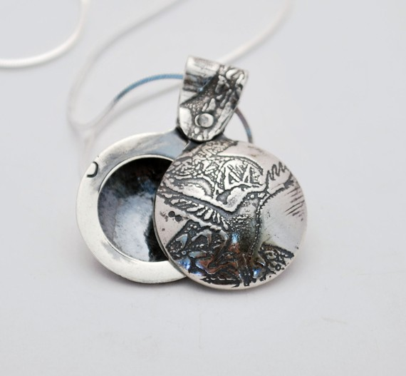 small silver crow swivel locket