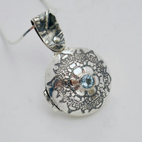 Sterling silver and blue topaz hinged locket