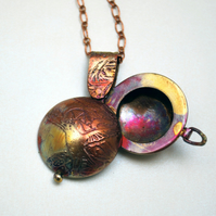 copper swivel owl locket