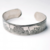 Steel wolf bracelet with celtic knot detail