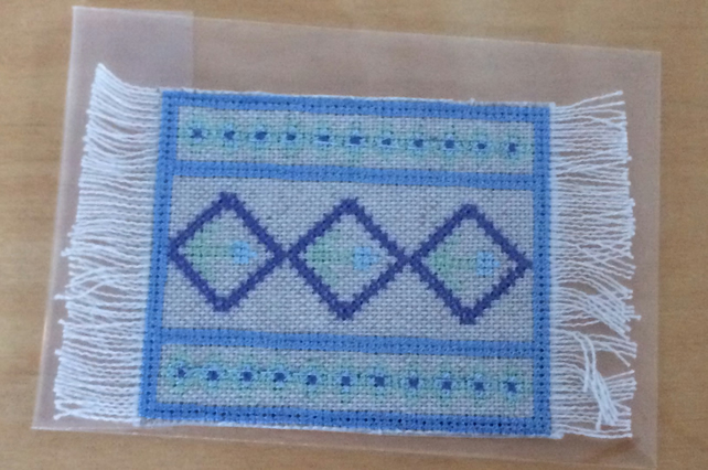 Miniature blue rug. 1:12 scale dolls house mat.