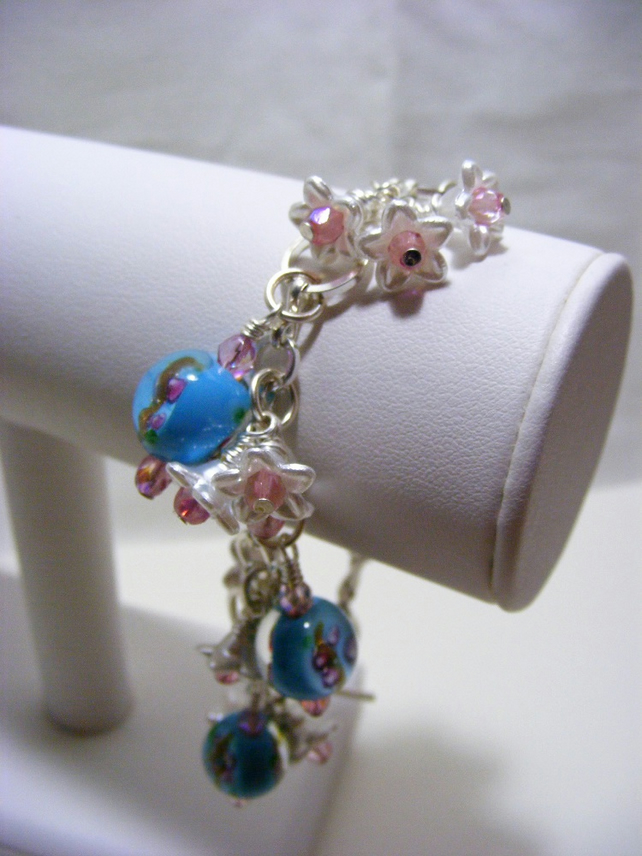 Pearlized Flower and Blue Glass  Charm Bracelet