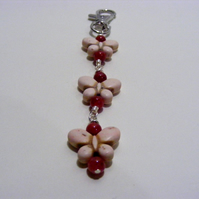 Magnesite Butterfly and Red Jade Bag charm
