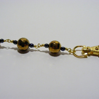 Gold and Black Hematite Bag Charm.