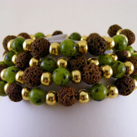 Green Dalmation Jasper and Lava Bead Memory Bracelet.