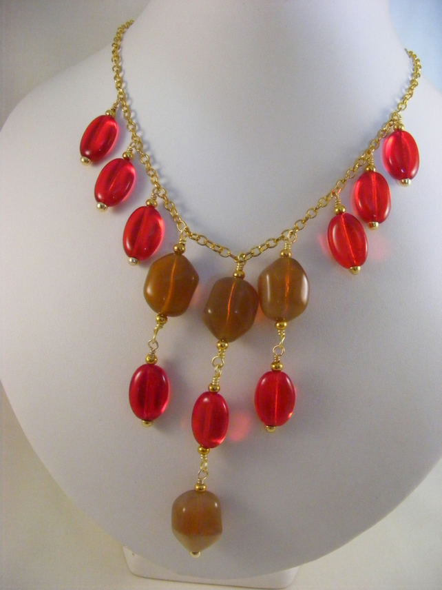 Brown and Red Glass Charm Necklace.