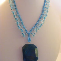 Blue Agate Pendant and Flower Necklace.