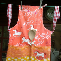 Child's Apron With Wooden Spoon