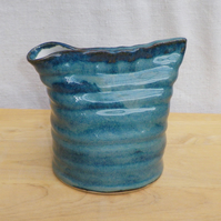 Jug or pitcher hand thrown in stoneware ceramic pottery.