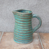 Jug or pitcher hand thrown stoneware pottery