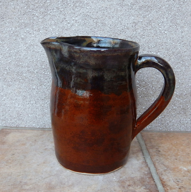 Jug or pitcher hand thrown in stoneware pottery ceramic