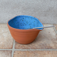Egg whisking bowl hand thrown terracotta mixing pouring with a whisk