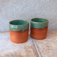 Pair of whisky tumbler or espresso coffee cups in terracotta hand thrown pottery