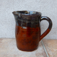 Jug or pitcher hand thrown in stoneware pottery ceramic handmade wheelthrown