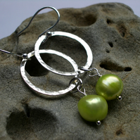 Silver hoop hammered earrings with pistachio green pearls