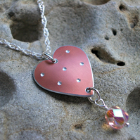 Heart pendant necklace in copper colour with spots